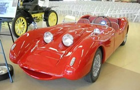 This is a picture of a red a prototype car that was never produced explained in the car bio that follows.