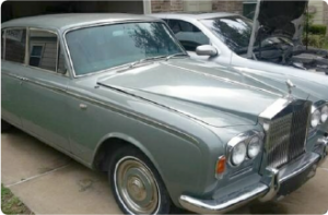 A photo of a 1967 Rolls-Royce Silver Shadow by Colin Melanson. The shot is a side angle shot of the silver car.