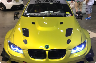 A photo of a 2011 BMW E92 M3 owned by Edison Hwang. The shot is a front angle shot of the yellow car.