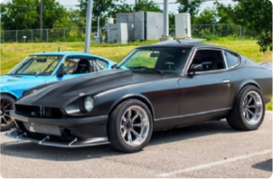 This is a side shot of a 1977 Datsun 280Z with matte black finish.