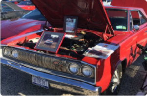This is a picture of a red 1967 Dodge Coronet R/T explained in the car bio that follows.