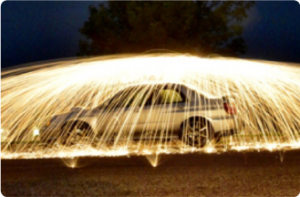 This is a picture of a 2005 Subaru Impreza WRX STi underneath what appears to be a lit up water fountain.